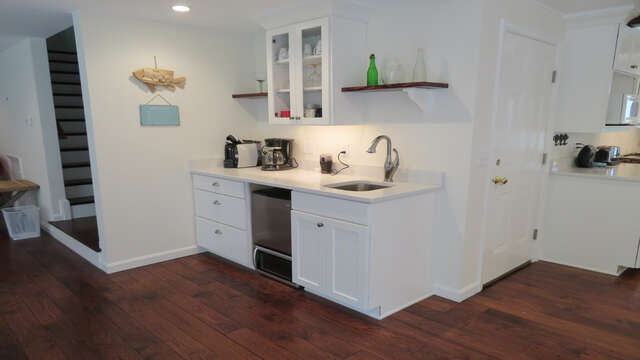 wet bar located conveniently between the kitchen and family room- stairs to left lead to the Private Master bedroom on 2nd flr-55 High Point Drive North Chatham Cape Cod - New England Vacation Rentals