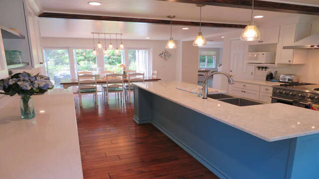 Over sized Cambria Quartz Island- 6 burner gas stove top with griddle and stainless appliances-55 High Point Drive North Chatham Cape Cod - New England Vacation Rentals
