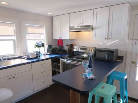 Kitchen offers all new appliances (no dishwasher) and a breakfast bar with 2 stools - 1047 Old Queen Anne Road Chatham Cape Cod - New England Vacation Rentals