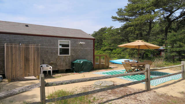 Overall view of outdoor dining area and outdoor shower- 1047 Old Queen Anne Road Chatham Cape Cod - New England Vacation Rentals