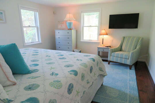 another view of 1st flr bedroom with TV -offers ensuite bathroom-1st floor bedroom with Queen bed. 55 High Point Drive North Chatham Cape Cod - New England Vacation Rentals