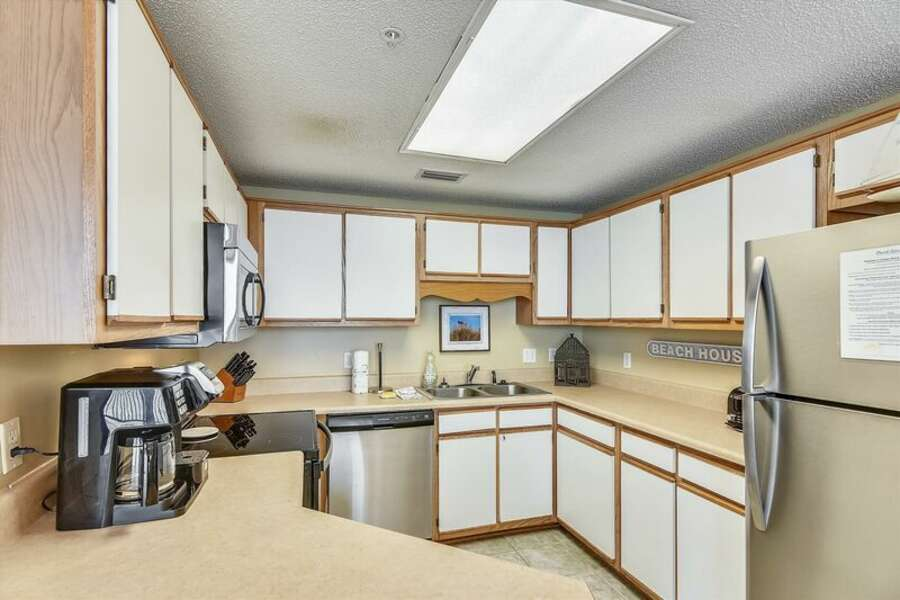 Newly updated Kitchen Features Stainless Steel Appliances and a Breakfast Bar