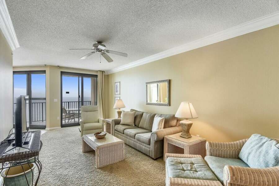 The spacious living room has plenty of comfortable seating and a queen size sleeper sofa.