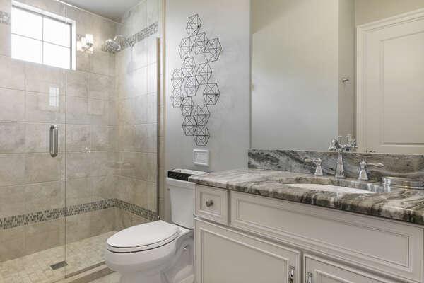 Master en-suite bathroom with glass door walk-in shower