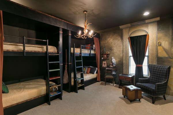 Custom Kid`s Bedroom features two twin over twin bunk beds