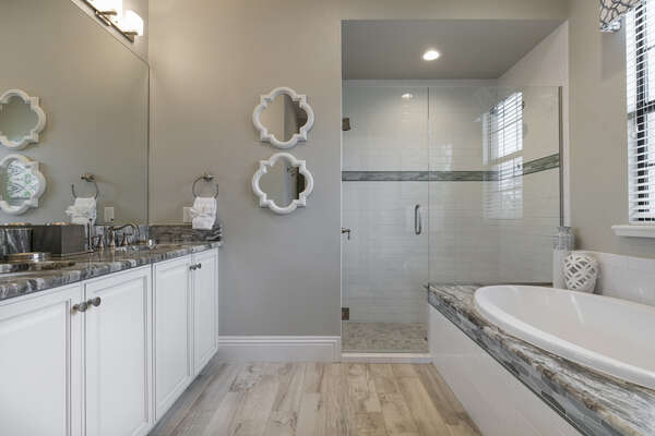 The en-suite bathroom features a walk-in shower and garden tub