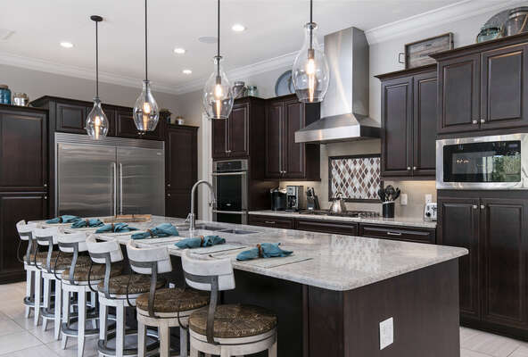 Spacious kitchen area with a breakfast bar
