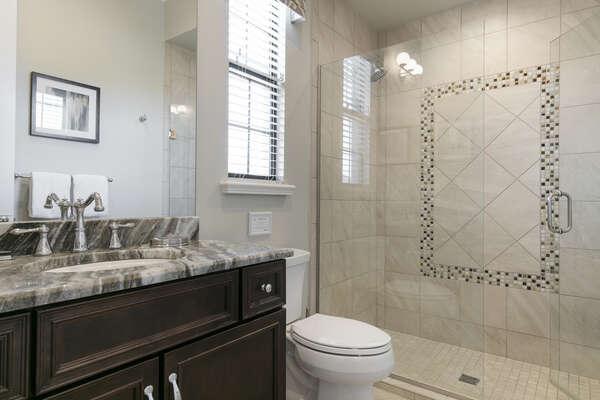 En-suite bathroom with glass door walk-in shower