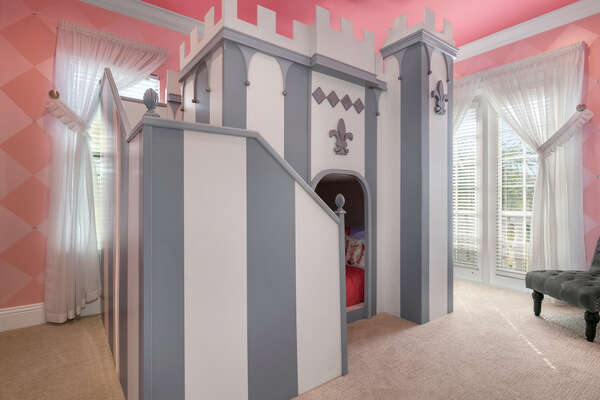 The princess room has a custom built twin over twin bunk bed