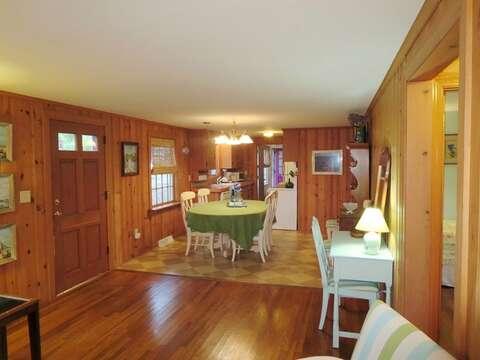 View of the open living/dining/kitchen area, there is even a small desk to write out post cards or catch up on work! - 23 Ginger Plum Lane Harwich Port Cape Cod - New England Vacation Rentals