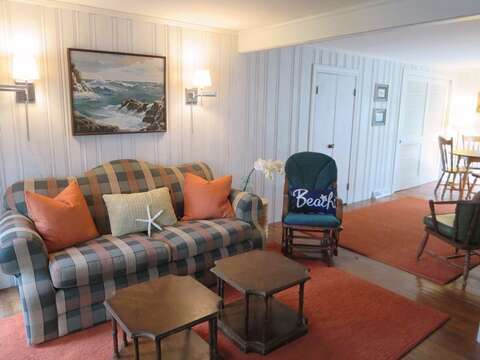 Bonus living area with a tv, seating, and a game table - 23 Ginger Plum Lane Harwich Port Cape Cod - New England Vacation Rentals