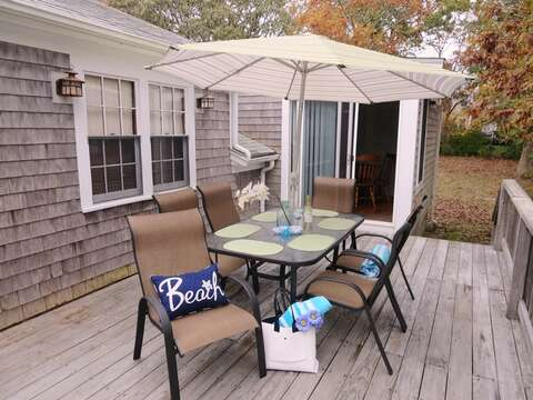 Sliders from the game room lead right out onto the deck  23 Ginger Plum Lane Harwich Port Cape Cod - New England Vacation Rentals