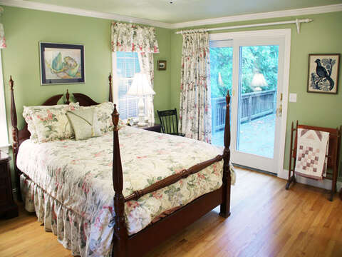 Master bedroom on 1st floor with sliders to back deck- 29 Ginger Plum Lane Harwich Port Cape Cod - New England Vacation Rentals