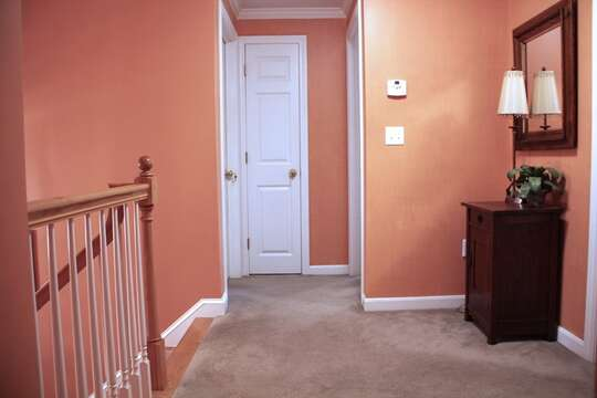 To the Left of the stairs is another bedroom and the full bath is in the middle-29 Ginger Plum Lane Harwich Port Cape Cod - New England Vacation Rentals