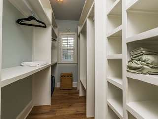 Spacious master closet with built-in custom shelving (on main)