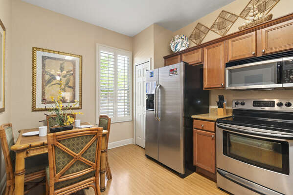 alternate view of kitchen showing dinette table
