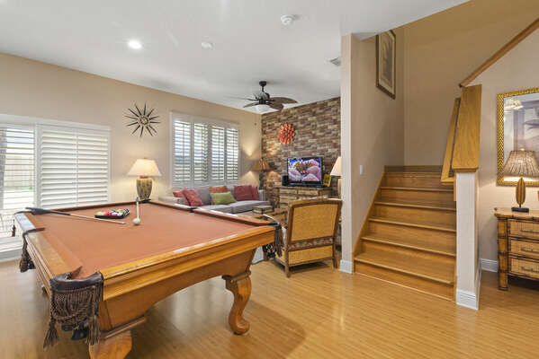 downstairs open floor plan showing pool table and living room