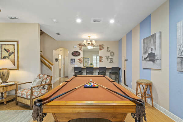 alternate view of pool table and breakfast bar seating