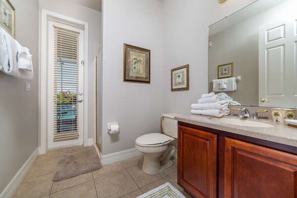 This bathroom has an entrance from the outside pool area.