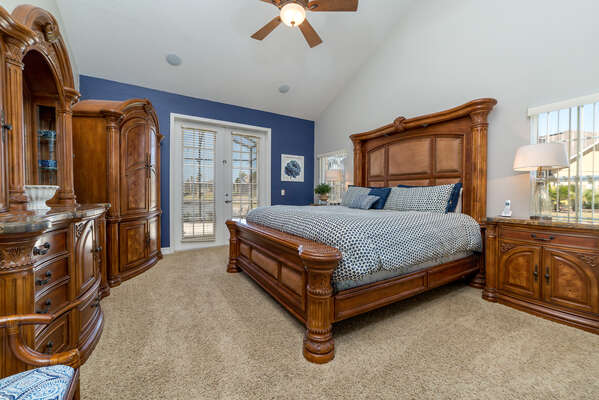 Relax in this light and airy downstairs king bedroom