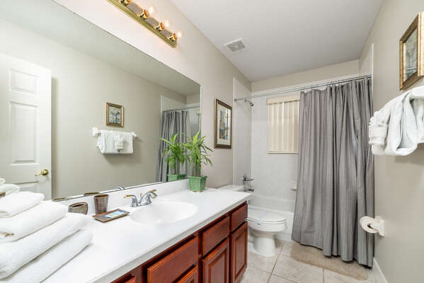This well lit bathroom is spacious and oversized bathroom
