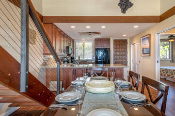 Dining Room and Kitchen Next to Wooden Staircase at Kona Hawaii Vacation Rentals
