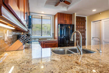 Full Kitchen with Plenty of Counter Space and Views of Outside at Kona Hawaii Vacation Rentals