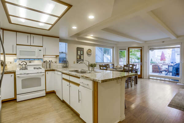 Fully Stocked Kitchen with Dishwasher and Dining