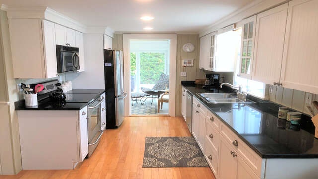 Enter into the fully equipped kitchen - 19 Burton Ave West Harwich Cape Cod - New England Vacation Rentals