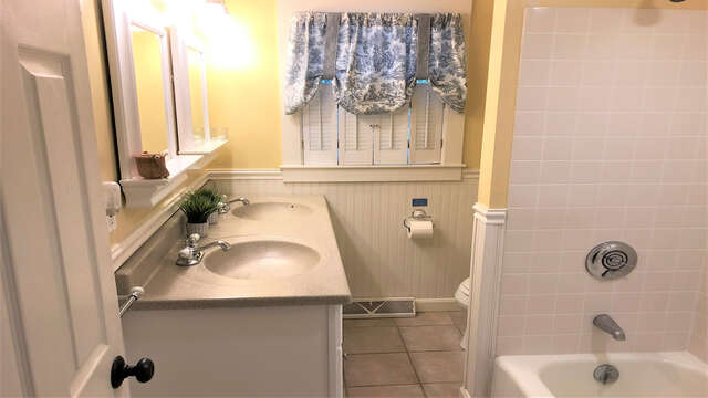 Full bathroom off of the hall with tub, shower, and double sink vanity - 19 Burton Ave West Harwich Cape Cod - New England Vacation Rentals