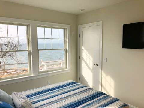 1st floor bedroom with Queen bed with 40 inch Flat Screen TV-  1 Bayberry Lane Eastham Cape Cod - New England Vacation Rentals