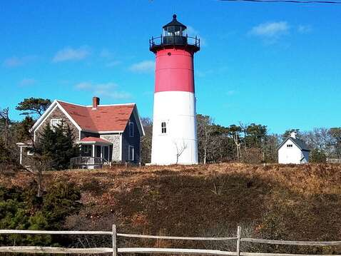 Visit Nauset Light, you may recognize this famous lighthouse from the Cape Cod Potato Chip bags! - Eastham Cape Cod - New England Vacation Rentals