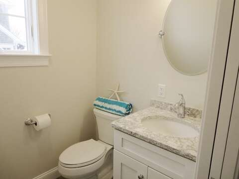 Half bath on first floor - great changing area as you come in from the deck - right inside the door from the outdoor shower-  1 Bayberry Lane Eastham Cape Cod - New England Vacation Rentals