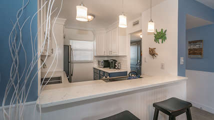 Fully equipped kitchen with microwave, Keurig, and all new appliances