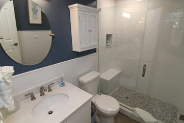 Brand new glass and tile shower.