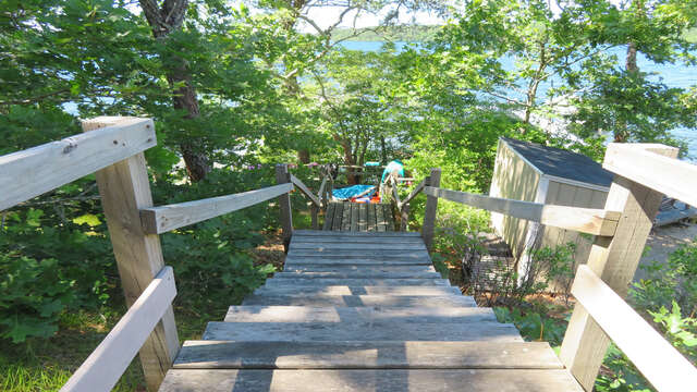 Steps down to Lake with private small sandy area - bring the paddle boards or kayaks down for you use! (use at own risk) 2 kayaks and 2 paddleboards provided-2 Mashpa Road Harwich Cape Cod - New England Vacation Rentals