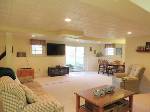 The lower level offers a flat screen TV and is a great space for the kids to watch a movie or play some board games - 2 Mashpa Road Harwich Cape Cod - New England Vacation Rentals