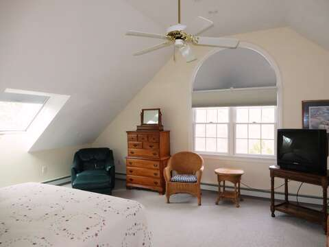 Located above the garage, Bedroom #2 has 1 Queen bed, 2 Twin Beds, and a TV - 2 Mashpa Road Harwich Cape Cod - New England Vacation Rentals