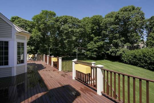 Large deck with outdoor furniture including a table & chairs. Gas grill as well - 2 Mashpa Road Harwich Cape Cod - New England Vacation Rentals