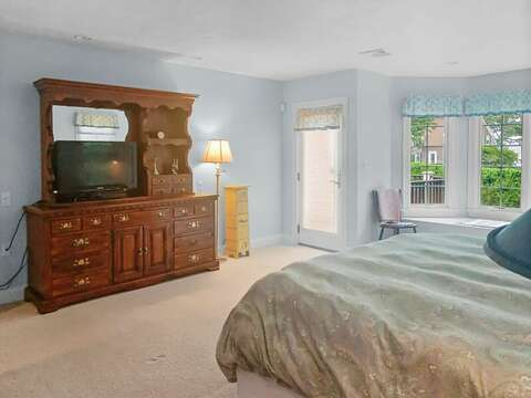 Bedroom #1 with a King bed, flat screen TV, and en suite bathroom - 2 Mashpa Road Harwich Cape Cod - New England Vacation Rentals