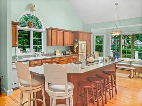 Large kitchen island with 2 seats at the breakfast bar - 2 Mashpa Road Harwich Cape Cod - New England Vacation Rentals