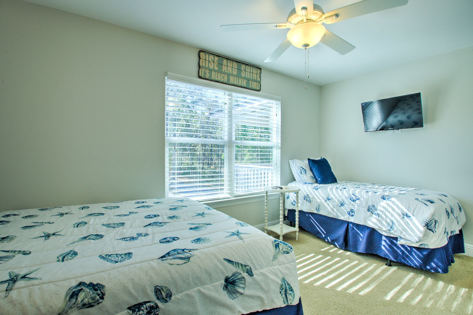 Bedroom Includes Two Beds and a Large Window.