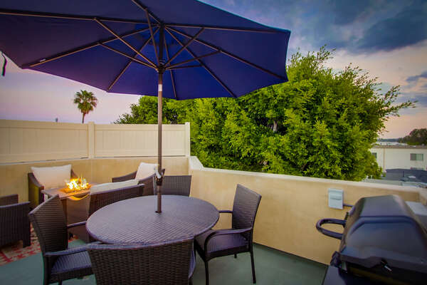 Rooftop patio with fire pit and BBQ