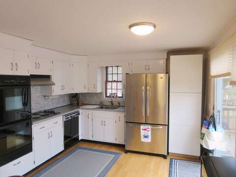 Fully equipped kitchen with dishwasher. Sliders to large deck - 84 Cranberry Lane Chatham Cape Cod - New England Vacation Rentals