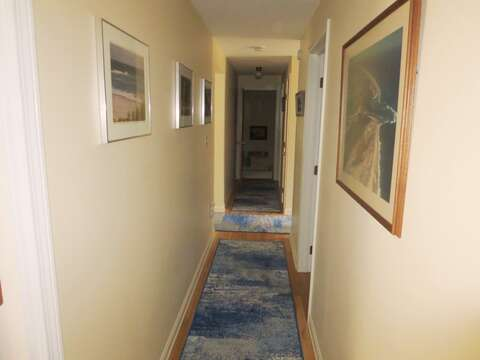 Hallway to Bedroom #2 and stairs to the lower level - 84 Cranberry Lane Chatham Cape Cod - New England Vacation Rentals