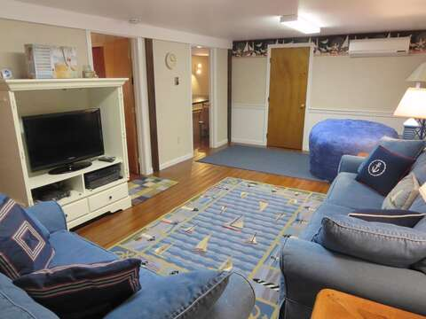 Lower level family room with large flat screen TV and slimline AC unit  - 84 Cranberry Lane Chatham Cape Cod - New England Vacation Rentals