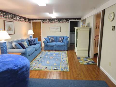 Family room. Straight ahead is the laundry area with a washer and dryer. To the right is bedroom 3 - 84 Cranberry Lane Chatham Cape Cod - New England Vacation Rentals