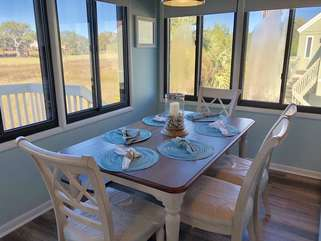 Gather around the pretty dining table and take in the view.