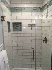 Another view of the Master Bath shower with a glass door.