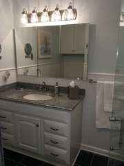 The Master Bath sink has a large mirrored medicine cabinet and magnifying mounted mirror.
